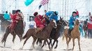 The Kazakh and US teams (blue and red, respectively) clash in kok-boru (buzkashi) at the 2nd World Nomad Games near Lake Issyk-Kul, Kyrgyzstan, in September 2016. [World Nomad Games official site]