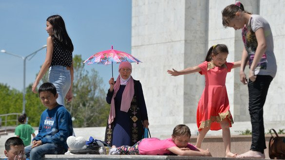 Kyrgyz children cool off in a fountain during celebrations of the 140th anniversary of Bishkek, their country's capital, April 29. The NGO Child Rights Defenders' League August 14 started the annual Take My Child to School campaign in Kyrgyzstan. [Vyacheslav Oseledko/AFP]