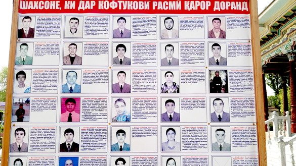 A wanted poster showing Naugilem residents accused of joining extremist organisations can be seen April 24. [Negmatullo Mirsaidov]