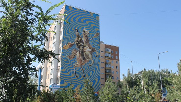 "A mural based on a sketch by Dmitry Levochkin achieves a 3D effect by using an ""optical graphic"" as the background in Astana August 14. The work depicts a descendant of Genghis Khan. [Aydar Ashimov]"