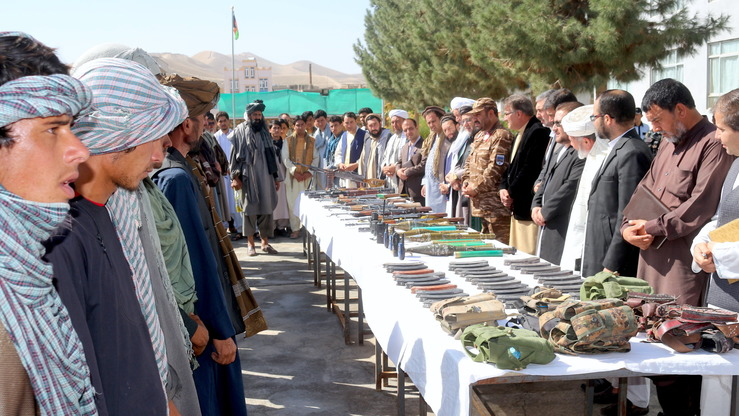 A group of 50 Taliban militants surrender their weapons and join the peace process in Badghis Province August 11. [Nasir Salehi]