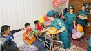 Police officers visit disabled children in Tashkent in June and give them presents. [Uzbek Interior Ministry]