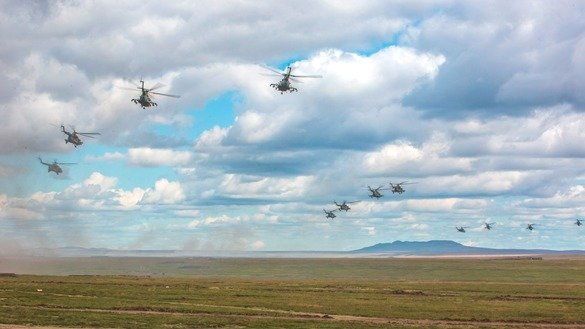 Russian helicopters take part in the country's largest ever military drills on September 11, 2018. [Russian Ministry of Defence]