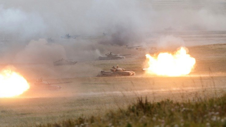 Russian tanks take part in their country's largest ever military drills September 13. [Russian Ministry of Defence]