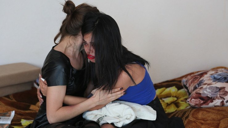 Two actresses portray victims of human trafficking during a law enforcement exercise in Koshi on September 27. [Aydar Ashimov]