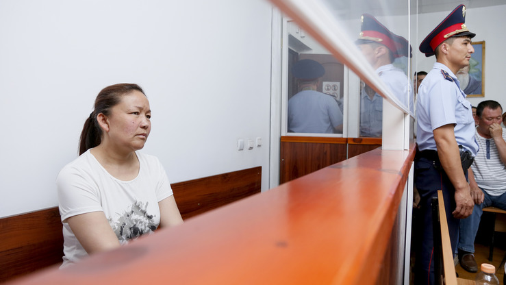 "Sayragul Sauytbay, 41, an ethnic Kazakh from China, awaits sentencing in Zharkent, Kazakhstan, July 13. Accused of illegally crossing the Chinese-Kazakh border to join her family in Kazakhstan, she received a suspended sentence August 1. Secretive ""re-education camps"" that allegedly hold hundreds of thousands of Muslims in western China became an issue during her trial. [Ruslan Pryanikov/AFP]"