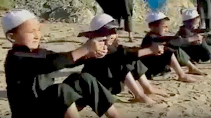 A screenshot from a video shows children, said to be Kazakh, undergoing training at an 'Islamic State' (IS) camp in Syria. Convicted Kazakh militant Nurkhan Seytkali posted the video online in September 2014. [File]