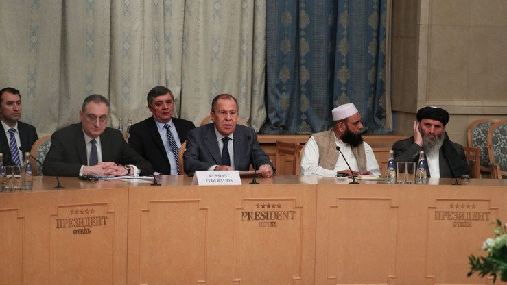 "Russian Foreign Minister Sergey Lavrov is shown with Taliban representatives during the first ""peace conference"" in Moscow last November. [Russian Foreign Ministry]"