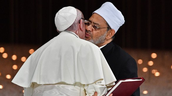 Pope Francis and Grand Imam of Al-Azhar Mosque Sheikh Ahmed al-Tayeb greet each other as they exchange documents during the Human Fraternity Meeting in Abu Dhabi February 4. [Vincenzo Pinto/AFP]
