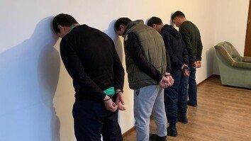 Detained residents of Turkestan Province accused of terrorism propaganda can be seen in this photo taken February 14. [National Security Committee of Kazakhstan]
