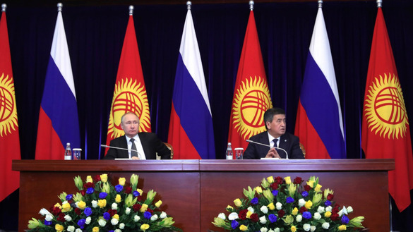 Kyrgyz President Sooronbay Jeenbekov and Russian counterpart Vladimir Putin field reporters' questions in Bishkek March 28. Putin's visit sparked protests by Kyrgyz expressing outrage at his policies. [Kremlin]