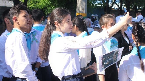 First-year medical students taking selfies at a square in Taraz, Kazakhstan, on May 9. [Aydar Ashimov]