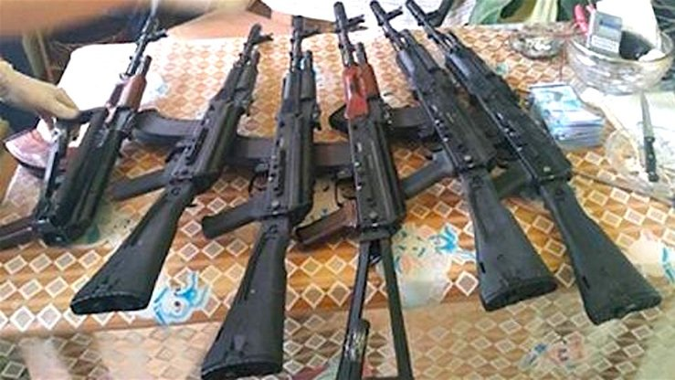 Weapons seized by Kazakh authorities are on display July 18. [Kazakh KNB]