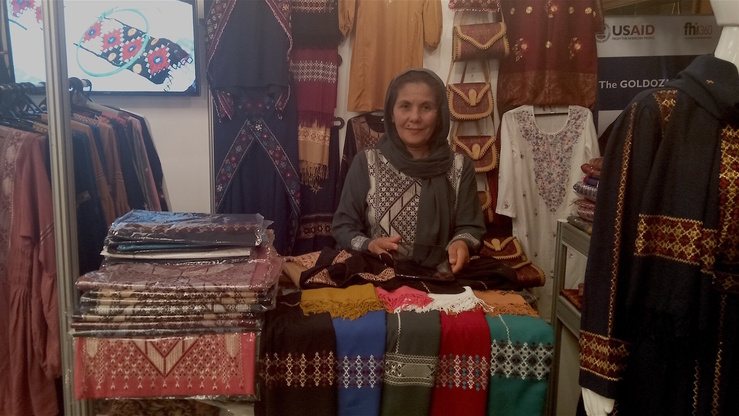 Zahro Kazemi of Bamiyan Province, Afghanistan, pictured here, sells women's dresses, shoes, bags and scarves at an exhibition in Almaty August 3. [Ksenia Bondal]