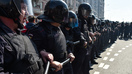 Mass beating of Kyrgyz migrants by Russian police sparks outcry